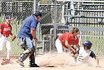 Williams Little League Scrappers player Johnathan Hernandez slides into home plate Saturday after an in-field home run during a 10-0 game against the Grand Canyon team