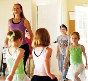 Young dancers get their groove on with instructor Marisa Masson of Stepping Out Dance Company.