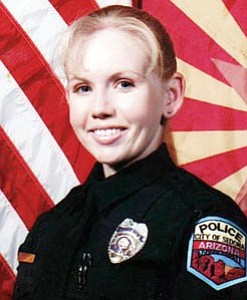 Rena Dearden, an officer with the Sedona Police Department, was chosen as this year's Student Resource Officer by the Arizona School Resource Association. Deadren, right, graduated from Williams High School in 1997 at the age of 17.