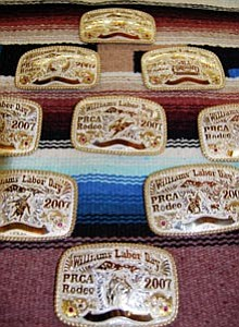 Buckles for this year's rodeo, picured above, are currently on display at DeBerge Gallery and Western Wear.