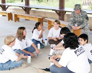 Thirty-five students from Williams Elementary-Middle School take part in the Freedom Academy, held Aug. 17-19 in Prescott. Students learned a number of challenging leadership skills during the camp and participated in physical challenges, such as climbing a wall.
