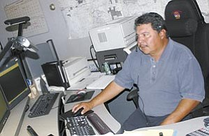 Sam Espinoza, director of support services for the Williams Police Department, works dispatch at the police department. The new tip line will offer callers the chance to remain anonymous.
