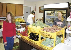 Volunteers at the Williams Food Bank, pictured above, prepare to open their doors Nov. 9. The group will begin handing out their Thanksgiving food boxes today. Fresh vegetables, pictured below, await individuals at the food bank as well as a number of other assorted food items.