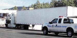 The suspect tractor-trailer involved in the Dec. 13 pursuit, pictured above, was finally brought to a halt along Route 66 near Denny's Restaurant after a Williams Police Officer was forced to shoot at the vehicle's tires.