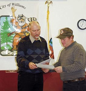 Sheldon Johnson, pictured right, receives an award from Mayor Ken Edes during the regularly scheduled meeting of Williams City Council Dec. 13. Johnson, as well as the rest of the Williams Maintenance Department, were honored for their recent work in building a new sanitation truck for the city of Williams.