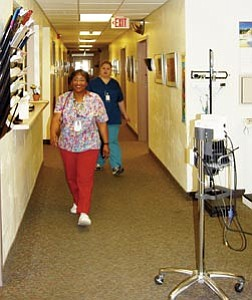 Health care employees, such as RN Nell Brown and medical assistant Christine Porr, pictured above, have seen an increase in illnesses at the Williams Banner Health Care Center, though no true cases of influenza have yet to be documented in the Williams area.