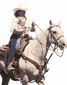 Terri Beeson, along with her son, leads the way in the first annual Ken McDaniel Memorial Rodeo, held in 2004. Plans are already under way for this year's rodeo in Williams.