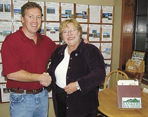 Bankers Real Estate broker/owner John Rushton and new Parks branch manager Carol Bultema.