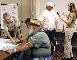 Forest Service officials meet with citizens last May to explain the travel management proposal. More meetings are planned this month.