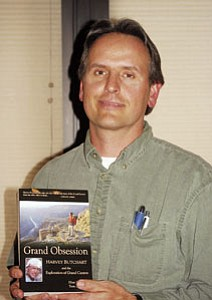 "Co-author Tom Myers holds up a copy of his newest Canyon-related book, ""Grand Obsession"" ($19.95, Puma Press, P.O. Box 30998, Flagstaff, AZ 86003), during the April 3 regular meeting of the Williams Rotary Club."
