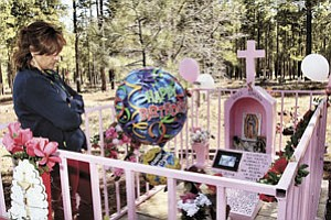 Maria Davalos visits the grave of her daughter, Dulce Davalos, who would have been 18-years-old April 21.