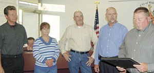 Grand Canyon Railway employees Frank Dowhan, Renee Wozniak and Wayne Rice received awards from Williams Mayor Ken Edes and Williams Police Chief Herman Nixon for their help in apprehending suspects in a recent theft and forgery ring during the regular meeting of Williams City Council May 22.