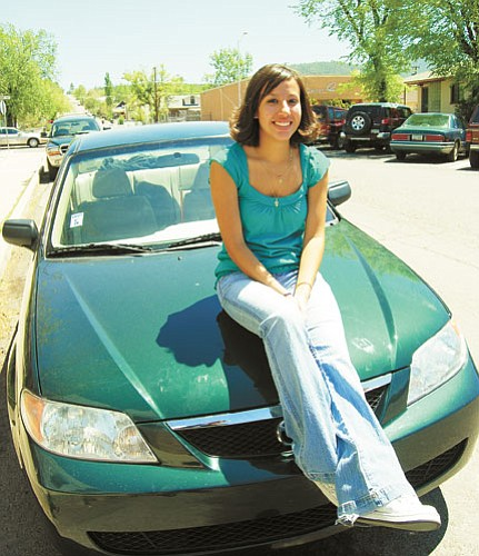 Patrick Whitehurst/WGCN<br> Leticia Aguilar proudly displays her 2002 Mazda. She won the vehicle at the conclusion of the grad night party that followed the graduation ceremony May 23.