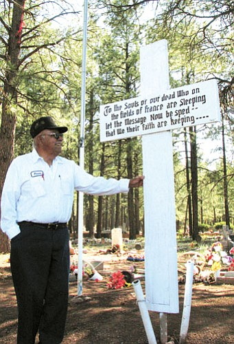 """Lynda Duffy/WGCN<br> Fred """"Perico"""" Avila smiles proudly at the cross he renovated just in time for the May 26 Memorial Day Service at the Williams Cemetery."""