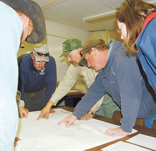 Patrick Whitehurst/WGCN <br> Forest users look over forest maps at a recent work session held by the Forest Service in April in order to offer their input on the national Travel Management Rule.