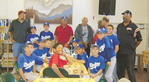 <b>Submitted photo</b><br /><br /><!-- 1upcrlf2 -->The Dodgers celebrate a June 7 victory against Seligman with a pizza and ice cream party hosted by the players' parents and the Bill Williams Seniors at the Williams Senior Center.