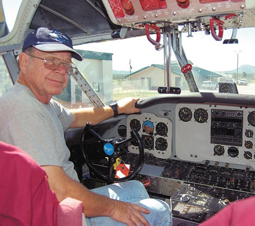 <br>Patrick Whitehurst/WGCN<br> Hans Lauridsen sits in the cockpit of his 1953 Grumman Albatross at the H.A. Clark Memorial Airfield in Williams.