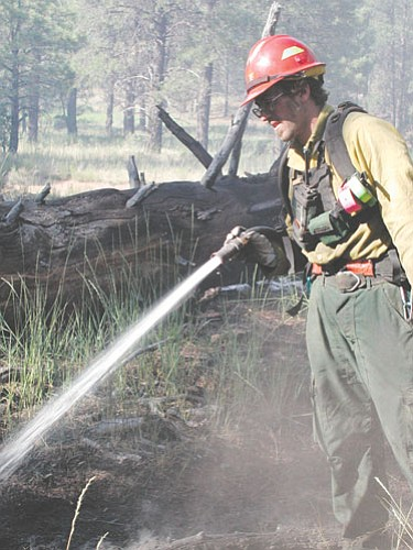 <br>Submitted photo<br> A firefighter fights a fire on the Kaibab National Forest.