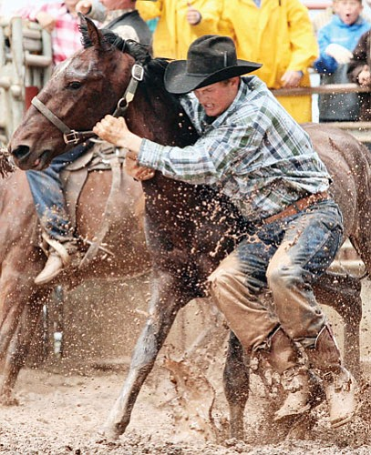 <br>Scott Warren/Williams Color Lab<br> A rider takes part in the 2007 Cowpuncher's Reunion Rodeo.
