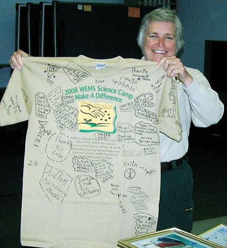 <br>Submitted photo<br> Williams District Ranger Martie Schramm smiles as she accepts a T-shirt designed by students that attended a science camp in April.