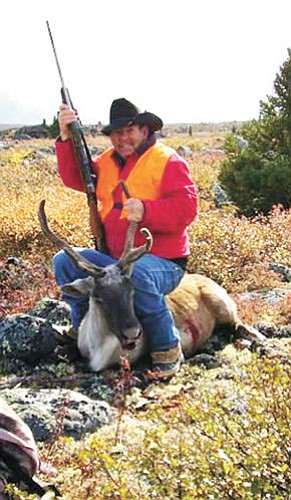 Bob Dean poses proudly with the caribou he bagged on his 70th birthday in Quebec, Canada. Bob and his son, Delbert, spent six days on the tundra approximately 1,000 miles north of Montreal.