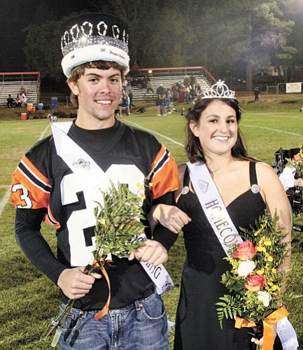 <br>Scott Warren/Williams Color Lab<br> Homecoming King Trevor Parenteau and Homecoming Queen Niki Maestas smile after being crowned during the Oct. 10 Williams High School Vikings football game. First runner up for Homecoming royalty was Emily Briggs and Alex Ruiz. Second runner up for Homecoming royalty was Keaton Hagemon and Ariel Pixley.