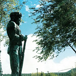 <br>Patrick Whitehurst/WGCN<br> Smoke from a controlled burn near Williams, as seen from the statue of Bill Williams at Monument Park.