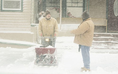 <br>Patrick Whitehurst/WGCN<br> Buffalo Pointe Inn employees clean snow Dec. 18.