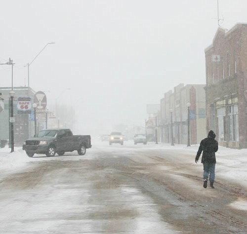 <br>Patrick Whitehurst/WGCN<br> A lone pedestrian crosses Route 66 in downtown Williams Feb. 9.
