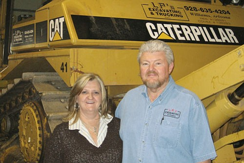 <br>Submitted photo<br> Larry and Lori Pittenger will celebrate 30 years of business in July of this year. The owners of L.P.'s Excavating were also recently named finalists for Contractor of the Year by Equipment World Magazine.