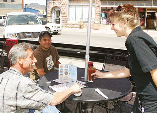 <br>Patrick Whitehurst/WGCN<br> Kaitlyn Scruggs waits on a table at Cruiser's Cafe in downtown Williams.