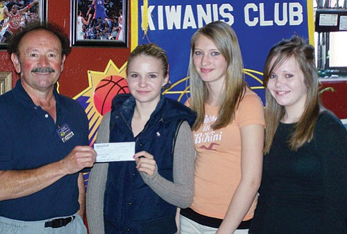<br>Photo/Sue Atkinson<br> Williams Kiwanis member Ernie Hernandez presents a check for $200 to Karrina Rotter, April Zicopoulos and Jessie Durnez from the Williams Elementary-Middle School.