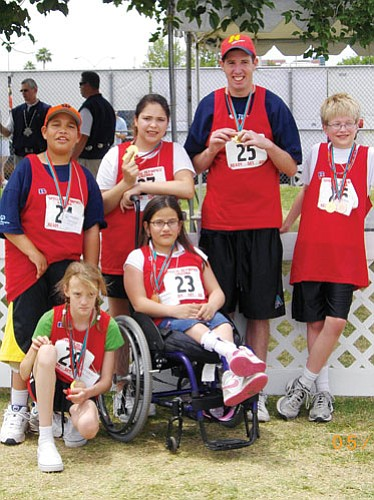 <br>Submitted photo<br> Local athletes smile for the camera during the recent Special Olympics State Summer Game Competitions. Pictured are (back row, from left) Bohannon Irving, Santia Rodriguez, Mark Konkel and Thomas Markham; (front row, from left) Alicia Wilson and Karime Galaviz.