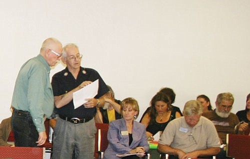 <br>Patrick Whitehurst/WGCN<br> Al Dunaway (standing right) goes over designs for a mural with city official Glen Cornwell at the May 14 meeting of Williams City Council. Dunaway is seeking to put the mural on Route 66 between First and Second Street for the Grand Canyon American Legion Post 42.