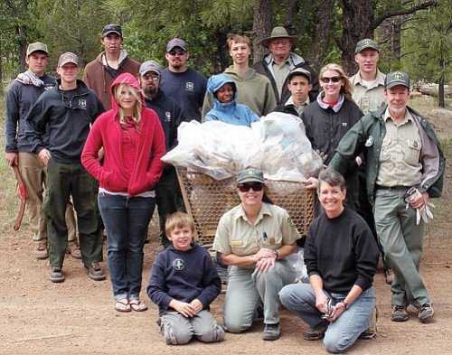 <br>Photo courtesy Kaibab National Forest<br> Some of the National Trails Day participants surround a shopping cart, which was found in the woods near the Buckskinner Trailhead. The cart is filled with 12 bags of trash that were collected during the clean-up effort.