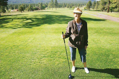 <br>Patrick Whitehurst/WGCN<br> Golfer Sharon Gibson prepares for a morning round of golf June 18 at Elephant Rocks Golf Course. Elephant Rocks is open seven days a week.
