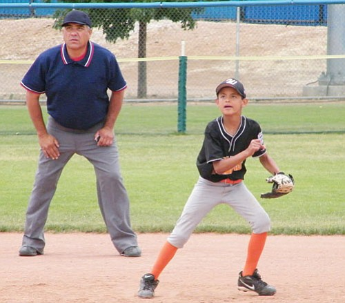 <br>Submitted by Jeanette Perkins<br> All-Star Daniel Lopez goes after the ball in a recent game as Umpire Fred Garcia watches in the background.