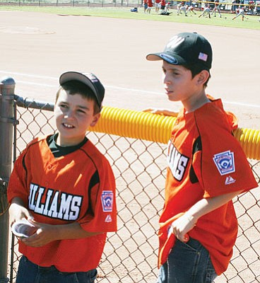 <br>John Christian Hopkins/WGCN<br> Colton Grantham, above, left, and Jose Acosta are all smiles as they await opening ceremonies for the District 10 Little League All Stars.