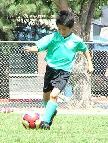 Photo/Cathy Grumbine <b>'Look, Ma, no hands!'</b> Jesus Pedraza, left, of the boys U10 team, controls the action during an AYSO soccer match.