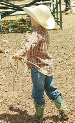Photo/Dennis Shirley A young cowboy practices his roping skills at the Bob Dean Rodeo Grounds during the Cowpunchers Reunion Rodeo in July. Organizers of the Labor Day Rodeo say the event will be similar to Cowpunchers.