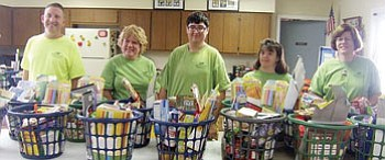 Photo/Guy Mikkelsen<br /><br /><!-- 1upcrlf2 -->Civitan Campers stand at the ready with gift baskets for local Williams families Aug. 22.