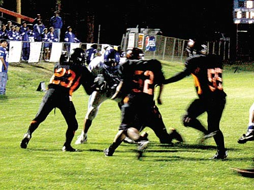<br>Ryan Williams/WGCN<br> Guy Forbis, 23, Eric Leon, 52, and Chuckie Sandoval, 55, shut down Hopi's offense on the 15-yard line at the close of the first half.