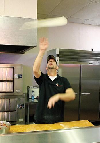 <br>Ryan Williams/WGCN<br> Derek Wortner displays his pizza dough tossing skills.