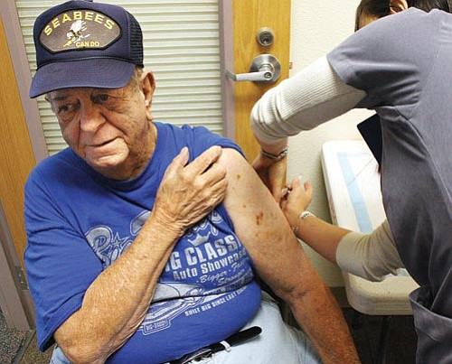 <br>Ryan Williams/WGCN<br> Jack Howison receives a seasonal flu vaccine at the Williams Health Care Center.
