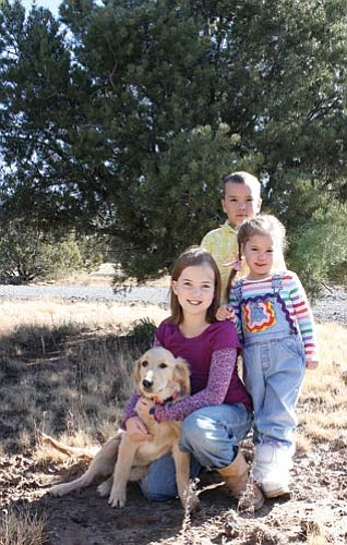 <br>Ryan Williams/WGCN<br> Bailee, Cole and Elly Cameron with their new Golden Retriever named Abby. The Humane Society, with the help of local Gail Cook, united the family with the 14-week-old dog following the loss of their family pet.