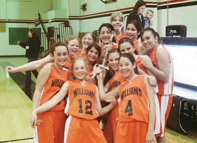 <br>Photo/Karyn White<br> The Falcons B Team celebrate after beating Parks to take first place in the I-40 tournament. Pictured is Carole Brown, Stephanie Wamble, Faythe Tanori, Anessa Amavizca, Autumn Lamm, Franchesca Pennington, Kaitlyn White, Gabby Guinta, Kaitlyn Zicopoulos, Becca Adams, Sierra Bates and Miranda Velazco.