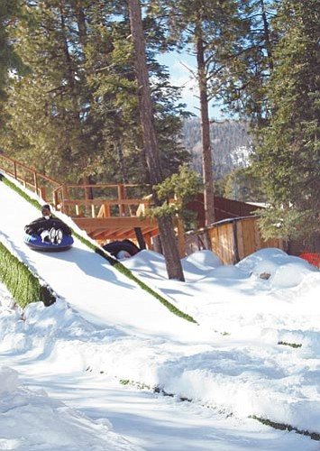Patrick Whitehurst/WGCN Tubers, skiers and snowboarders take advantage of abundant snow at Elk Ridge Ski and Outdoor Area located on Bill Williams Mountain south of Williams.