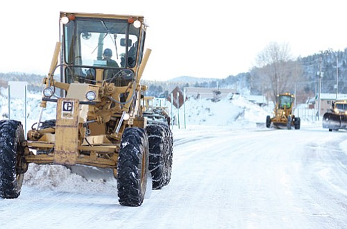 <br>Ryan Williams/WGCN<br> A snow plow moves snow off the road the morning of Jan. 19, following the first of three expected storms that began Jan. 18. Up to three inches of snow fell between Jan. 18-19, which caused schools in the Williams district to close Jan. 19.
