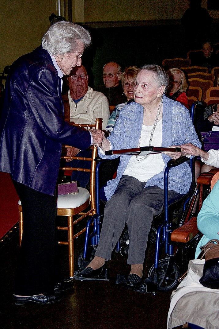 Elisabeth Ruffner shakes Ann Carson Dater's hand. Dater was awarded the Elisabeth F. Ruffner service award during the celebration of the 111th anniversary of the Elks Theatre and Performing Arts Center.
