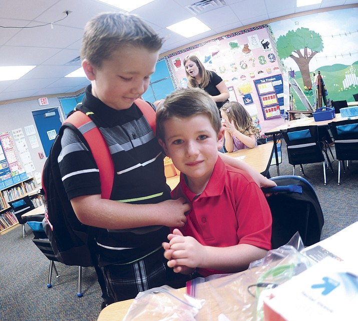 In this file photo, second-grader Joe Sarti gives his brother Nathan a hug on his first day of kindeåoln Elementary School as Prescott Unified School District begins the 2015-2016 school year.